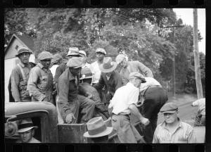 """Men coming to work at Greenbelt."" Carl Mydans, July 1936. Library of Congress. The badges they are wearing denote whether each man was a skilled or unskilled worker."