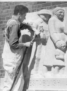 Lenore Thomas Straus at work on one of the bas reliefs that she sculpted for the New Deal project, Greenbelt, Maryland.